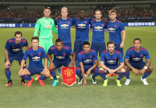 SHANGHAI, CHINA - JULY 22:  The Manchester United team line up ahead of the pre-season friendly match between Manchester United and Borussia Dortmund at Shanghai Stadium on July 22, 2016 in Shanghai, China.  (Photo by John Peters/Man Utd via Getty Images)